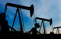 Oil falls in price due to high OPEC output