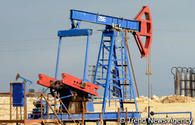 Oil prices fall as increased US drilling points to higher output