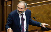 "Pashinyan ""learning"" the art of sitting on two chairs"