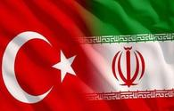 Turkey says to side with Iran in sanctions era