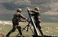 Armenian armed forces fire at Azerbaijani army's positions by using 82-mm mortars