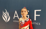 Gymnast representing Azerbaijan's AyUlduz club likes to perform complex elements