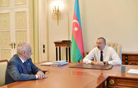 President Ilham Aliyev receives Deputy Prime Minister Hajibala Abutalibov as he submitted his resignation
