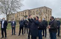 Turkic Council delegation members review Armenian-destroyed Aghdam Drama Theatre building